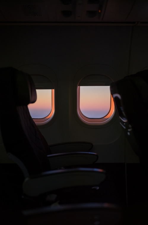 Sunrise through the windows of an aeroplane